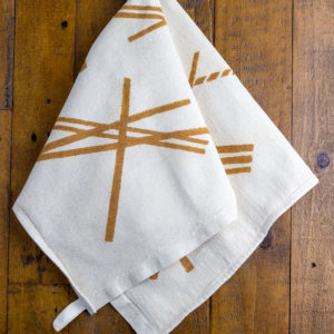 Rust printed Italian linen kitchen towel with geometric patter