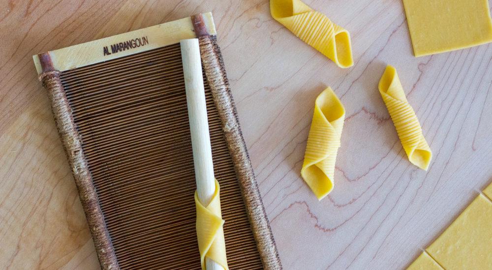 Homemade garganelli pasta with pasta comb