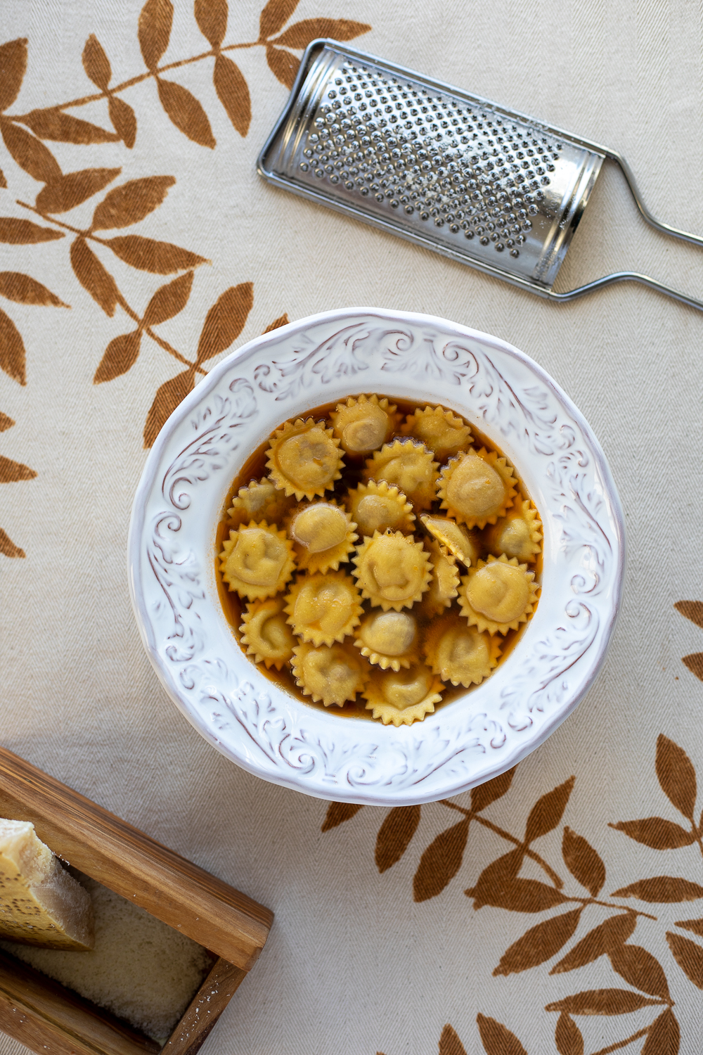 anolini in brodo with olive wood cheese grater and parmigiano - qbcucina.com