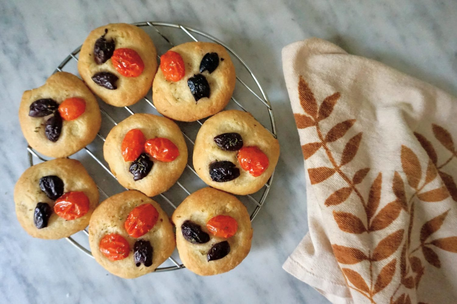 Mini focaccia with olives and tomatoes