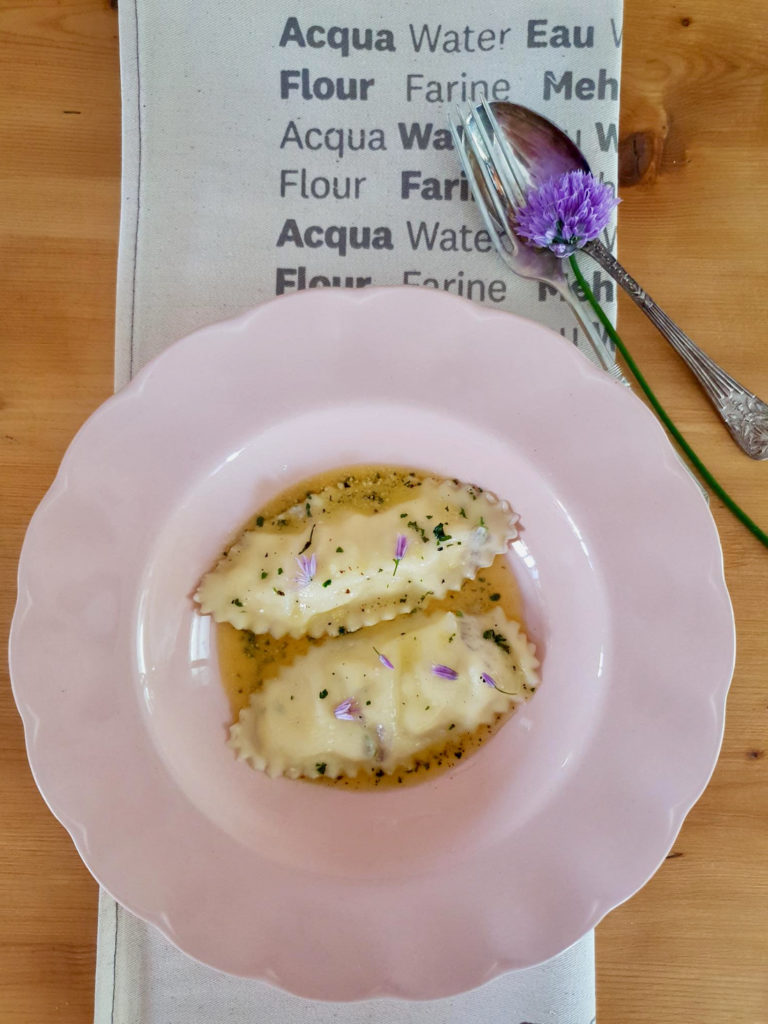 Oval chive flower ravioli with ricotta